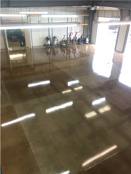 A checkered pattern adorns this polished concrete floor using brown and gray.