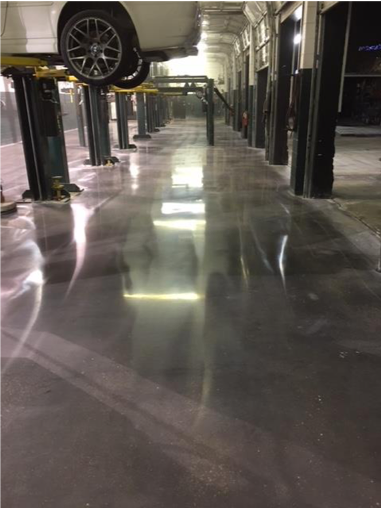 An image of beautiful polished concrete in a auto shop.