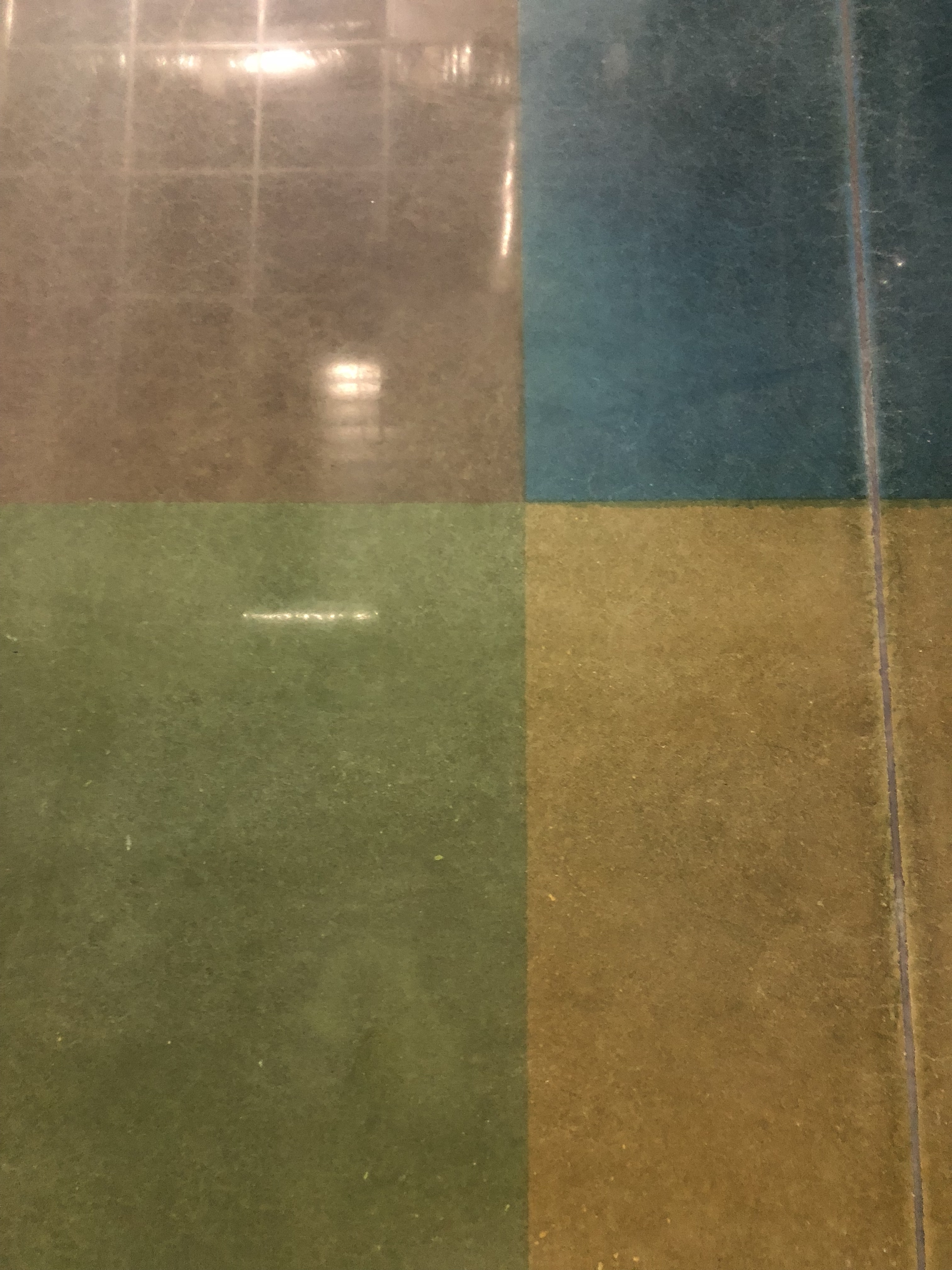 A gorgeous pattern for red, green, blue, and yellow polished concrete.